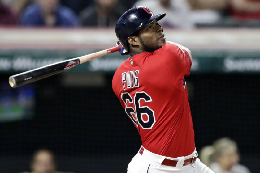 Cleveland Indians outfielder Yasiel Puig follows through on a swing.