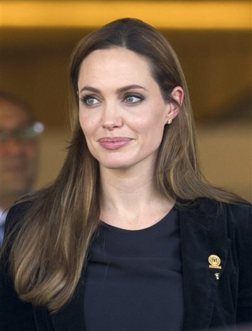 United Nations High Commissioner for Refugees, UNHCR, Goodwill Ambassador US actress Angelina Jolie leaves the UN building after delivering a speech at the 62th UNHCR Executive Committee at the European headquarters of the United Nations in Geneva, Switzerland, Tuesday, Oct. 4, 2011. (AP Photo/Keystone, Salvatore Di Nolfi) GERMANY OUT - AUSTRIA OUT