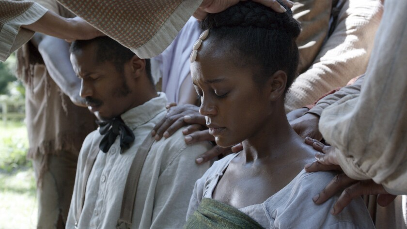 """Nate Parker as Nat Turner and Aja Naomi King as Cherry in a scene from """"The Birth of a Nation."""""""