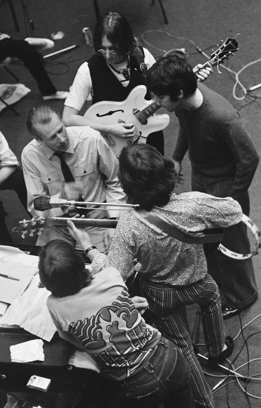 ***ONE TIME USE ONLY, ONLINE OK***CAPTION:The Beatles with George Martin during a recording session