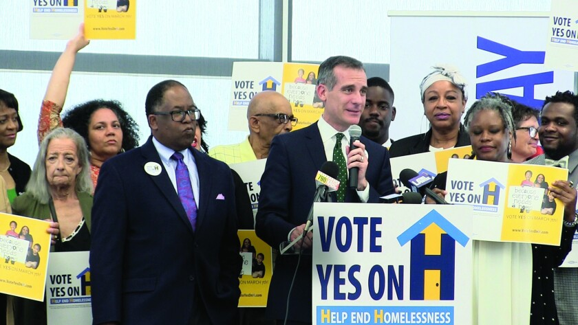 """(L-R) - Los Angeles County Supervisor Mark Ridley Thomas and Mayor Eric Garcetti in a scene from """"T"""