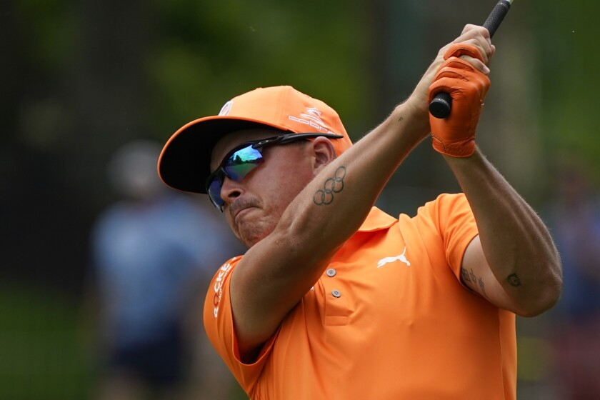 Rickie Fowler watches his shot into the second green during the final round of the Memorial golf tournament, Sunday, June 6, 2021, in Dublin, Ohio. (AP Photo/Darron Cummings)