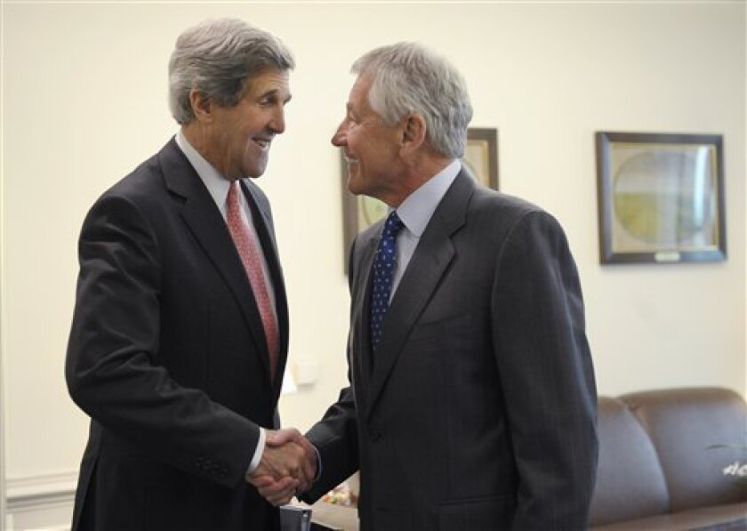 Defense Secretary Chuck Hagel, right, welcomes Secretary of State John Kerry, left, to his office at the Pentagon in Washington, Monday, May 6, 2013. Hagel invited Kerry to the Pentagon for a working lunch to discuss a range of national security issues. (AP Photo/Susan Walsh)
