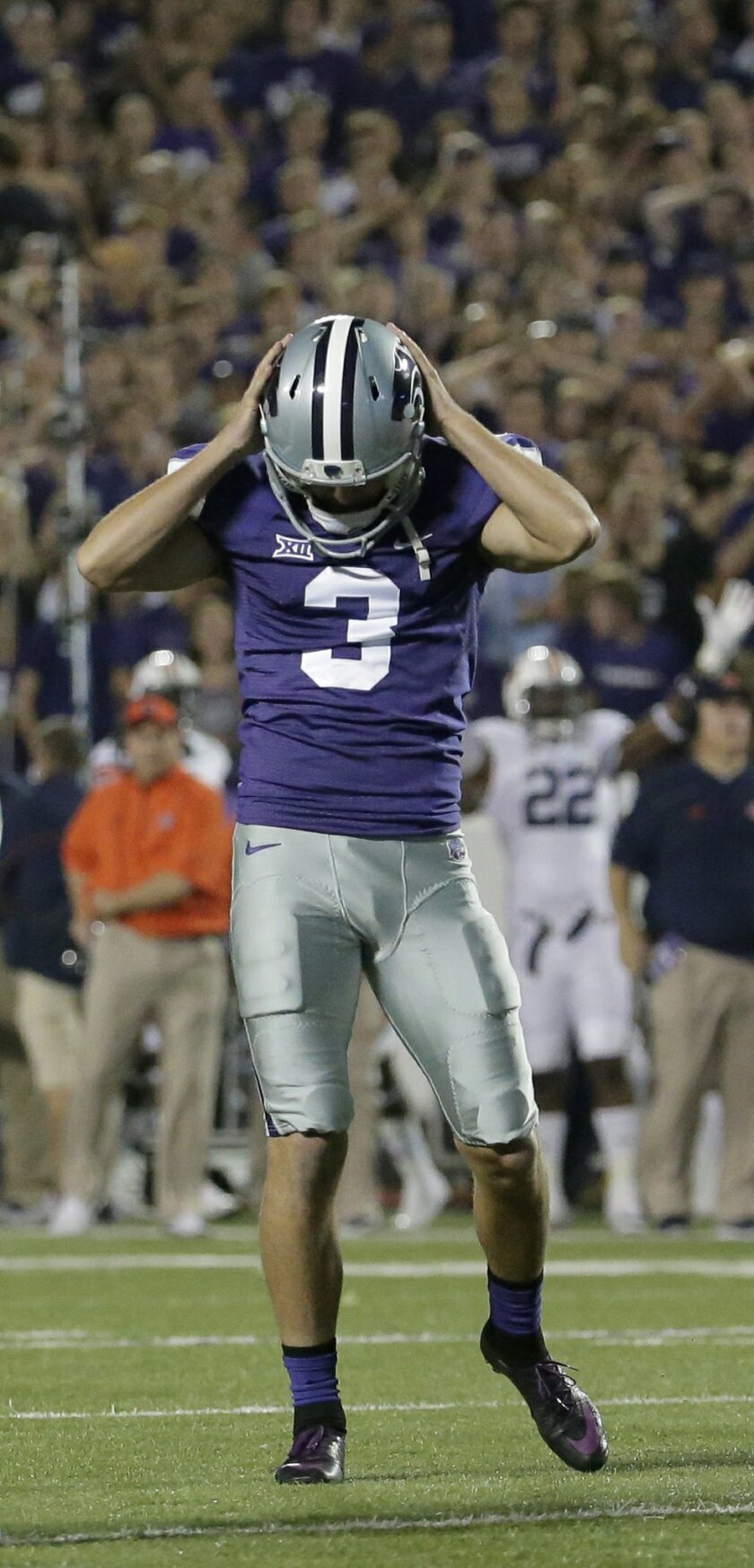 FILE - In this Sept. 18, 2014, file photo, Kansas State place kicker Jack Cantele (3) reacts after missing his third field goal of the game during the second half of an NCAA college football game against Auburn in Manhattan, Kan. In the year since the worst night of his football career, Cantele has learned perspective is everything when it comes to his story.(AP Photo/Charlie Riedel, File)