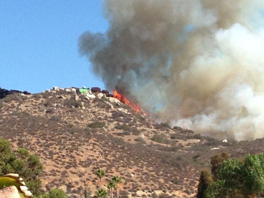 A Lakeside brush fire burned Sunday morning on Aquilla Drive near El Nopal.