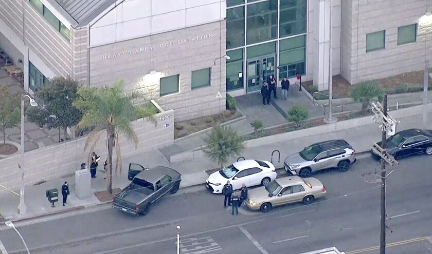 An aerial view of cars outside the Newton police station
