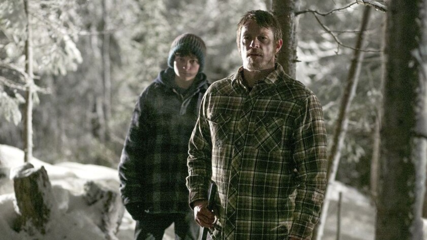 "Percy Hynes White, left, and Joel Kinnaman in the movie ""Edge of Winter."""