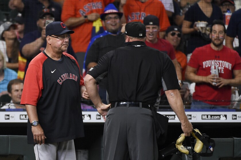 Cleveland Indians manager Terry Francona, left, talks with umpire Bruce Dreckman after a solo home run by Houston Astros' Jose Altuve during the third inning of a baseball game Tuesday, July 20, 2021, in Houston. (AP Photo/Eric Christian Smith)