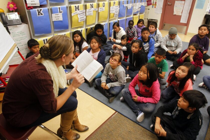 Teacher Tina Rasori reads to her 4th & 5th grade combined class last week at Fay Elementary School in San Diego. New common core standards for California schools have been implemented to change the way students are taught.