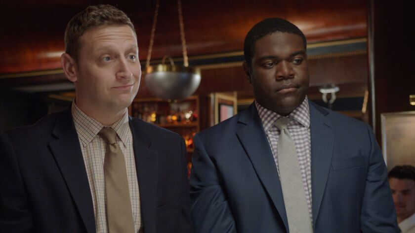 "Tim (Tim Robinson, left) and Sam (Sam Richardson) put on suits to impress a potential client in the Comedy Central situation comedy ""Detroiters."""