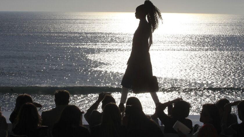 A model walks the runway at a fashion show Sunday in Leucadia featuring young women who are recent r