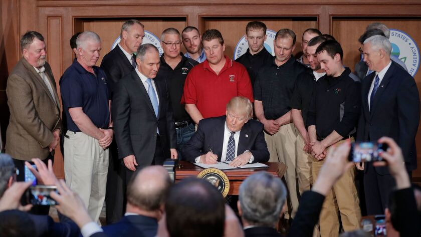 President Donald Trump signs an Energy Independence Executive Order, Tuesday, March 28, 2017, at EPA