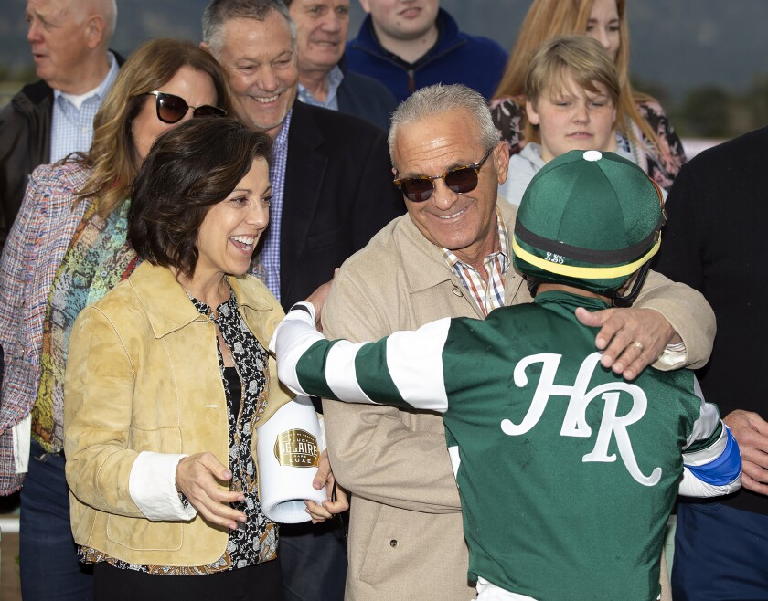 Combatant co-owners Stephanie and Kosta Hronis celebrate with jockey Joel Rosario after their victory in the $600,000 Santa Anita Handicap on March 7, 2020, at Santa Anita Park.