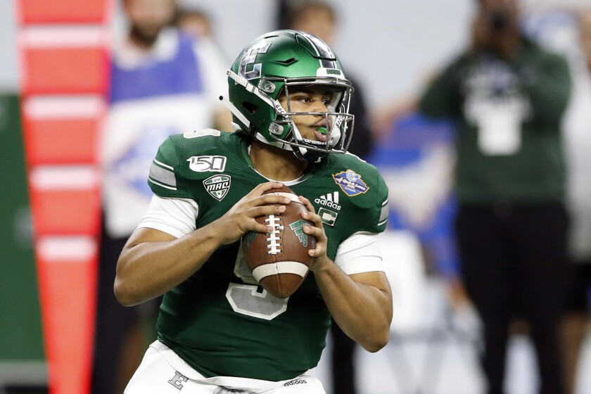 Eastern Michigan quarterback Mike Glass looks downfield during the first half of the Quick Lane Bowl against Pittsburgh.