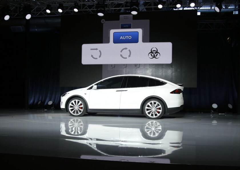 "A slide displayed during Elon Musk's Tesla presentation Sept. 29 shows an interface with a button for ""bioweapon defense mode."""