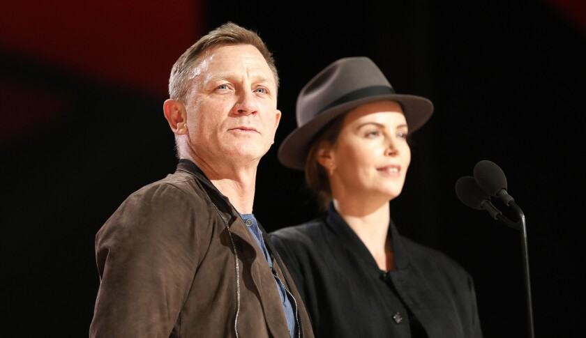 HOLLYWOOD, CA - FEBRUARY 23, 2019 Daniel Craig and Charlize Theron onstage during Saturday rehears