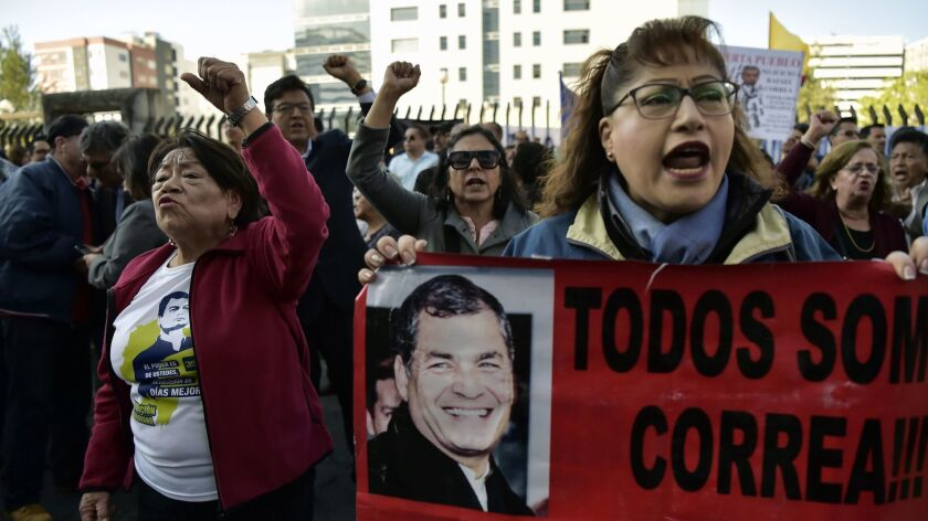 Supporters of Ecuadorean former President Rafael Correa, shout slogans while demonstrating outside the National Court in Quito, on November 07, 2018, as a judge decides if Correa will be tried for allegedly kidnapping an opponent in 2012.