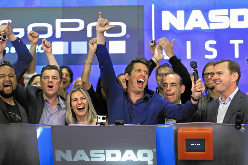 The stock market slide could lead to fewer initial public offerings by tech start-ups. Above, GoPro CEO Nick Woodman, center, celebrates his company's IPO in June 2014. The firm is growing fast on the backs of U.S. consumers — where demand remains strong.