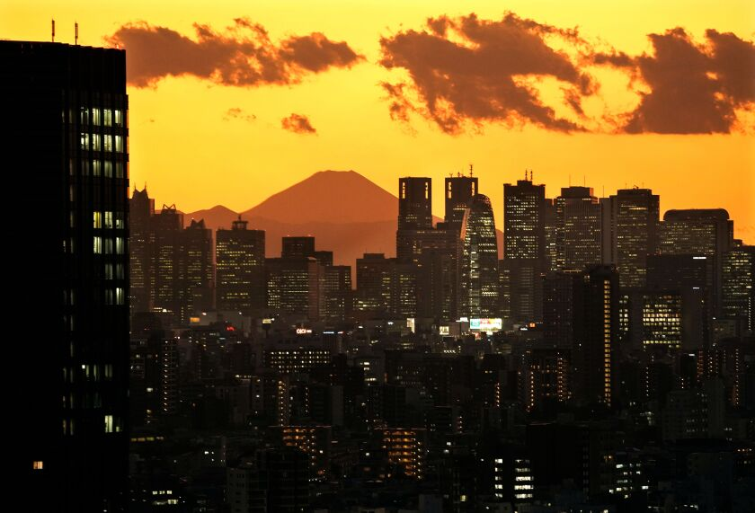 Mt. Fuji, Japan's tallest peak, as seen through Shinjuku skyscrapers. Japanese passport holders can access 191 countries without a visa.