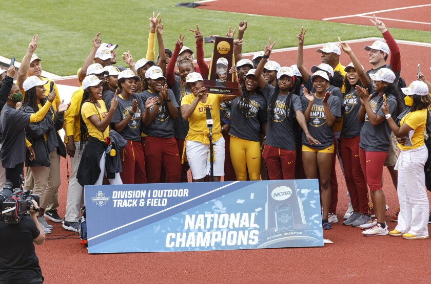 The USC women's track and field team accepts the trophy after winning the NCAA championship Saturday in Eugene, Ore.