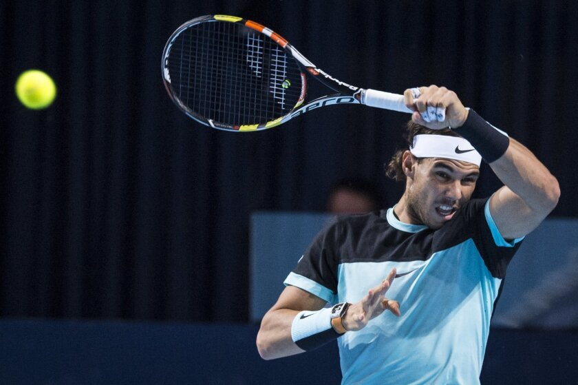 Spain's Rafael Nadal returns a ball to Switzerland's Roger Federer during their final match at the Swiss Indoors tennis tournament at the St. Jakobshalle in Basel, Switzerland, Sunday, Nov. 1, 2015. (Dominic Steinmann/Keystone via AP)