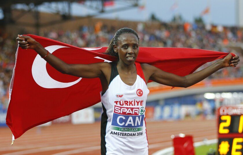 Turkey's Yasemin Can celebrates after winning the gold medal in the women's 5000m final during the European Athletics Championships in Amsterdam, the Netherlands, Saturday, July 9, 2016. (AP Photo/Matthias Schrader)