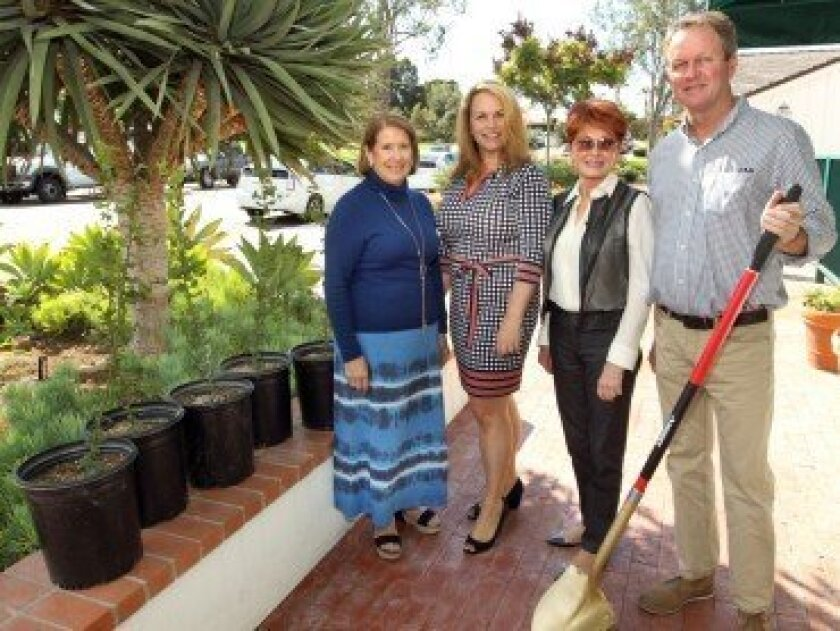 Esther Rodriquez, chairwoman of the Presidents Circle of the Country Friends; Rhonda Tryon, president, Country Friends; Jo Ann Kilty, chairwoman of the Presidents Circle of the Country Friends; and Arnold Keene, field operations manager for the Rancho Santa Fe Association. Below: some of the saplings that will be planted. Photos by Jon Clark