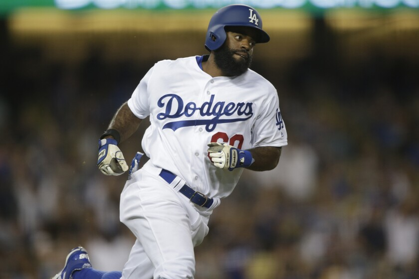 Dodgers outfielder Andrew Toles runs the bases