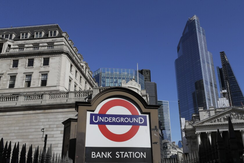 A blue sky over Britain's financial district in London, Monday, Sept. 28, 2020. Lawmakers and scientists have criticized Johnson's Conservative government for problems with the national test-and-trace program that was supposed to help control the spread of the disease and reduce the need for limits on social interactions. (AP Photo/Kirsty Wigglesworth)