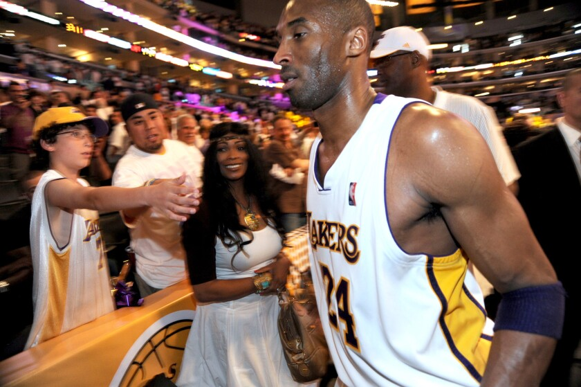 Lakers guard Kobe Bryant walks by his mother, Pam, following his team's victory over the Utah Jazz in 2010.