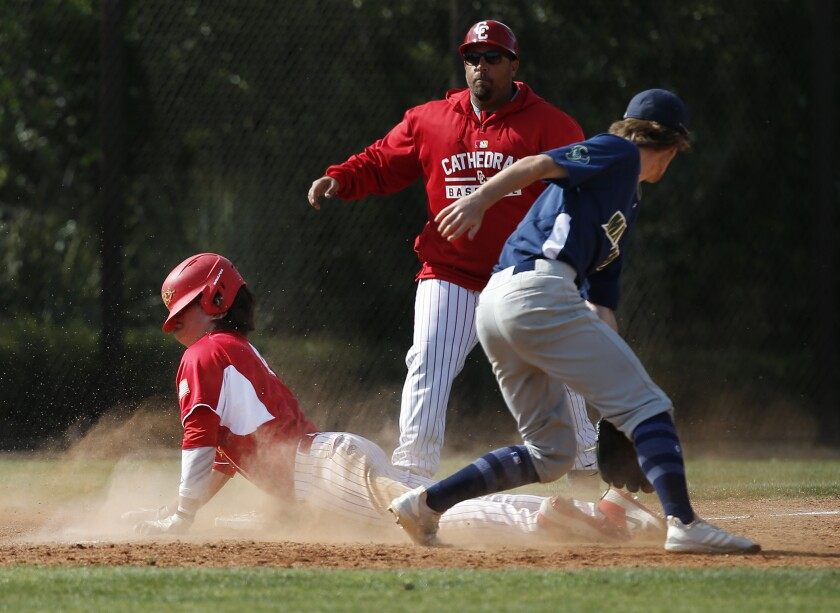 Cathedral Catholic's Nick Guerena slides safely into third and later scored, but it wasn't enough as La Costa Canyon defeated the Dons 8-7 in 10 innings in the Lions Tournament.