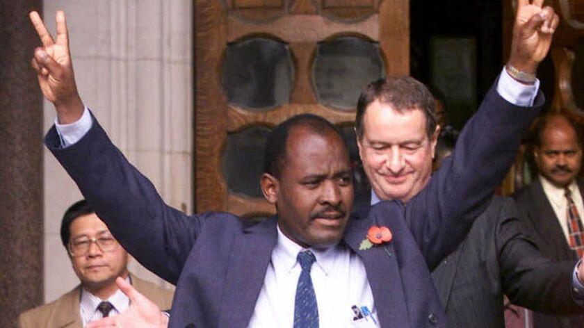 Chagos islander Louis Bancoult leaves the High Court, Central London, Friday, Nov. 3, 2000, followin