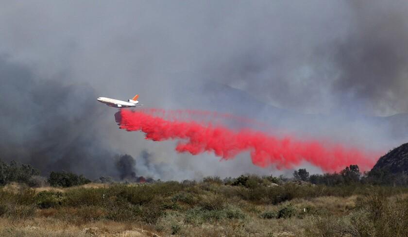 A plane drops fire retardant on the Maria fire in Ventura County
