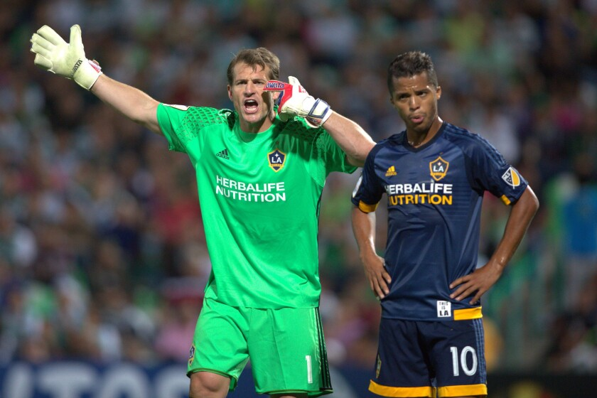 Galaxy goalkeeper Dan Kennedy, left, and midfielder Giovani Dos Santos are seen during a CONCACAF Champions League quarterfinal match last year.
