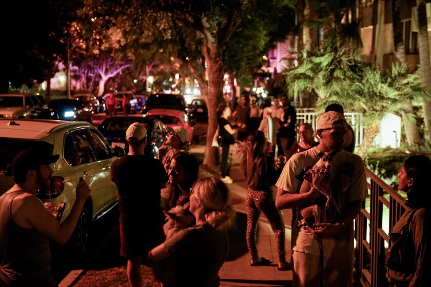 People gather outside Ed Buck's apartment complex in West Hollywood on Sept. 17. Buck was arrested and charged with operating a drug house.