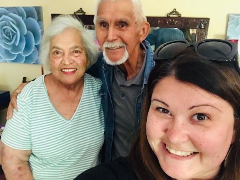 Kristine Shipman poses with her grandparents Elizabeth Rajcan-Nevarez and Ezekiel Nevarez in June.