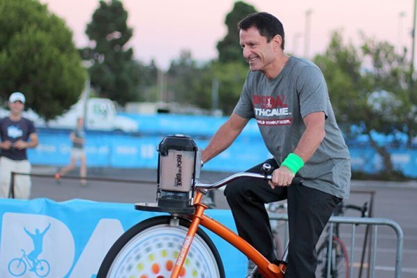 Dr. Scott Lippman pedals for the cause in 2014.