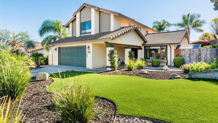 Photo of a home on 323 Elkhorn Lane, Escondido, 92026 for the 'What money buys' column.