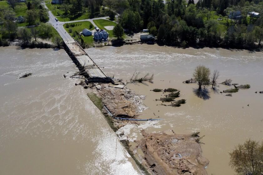 People survey flood damage