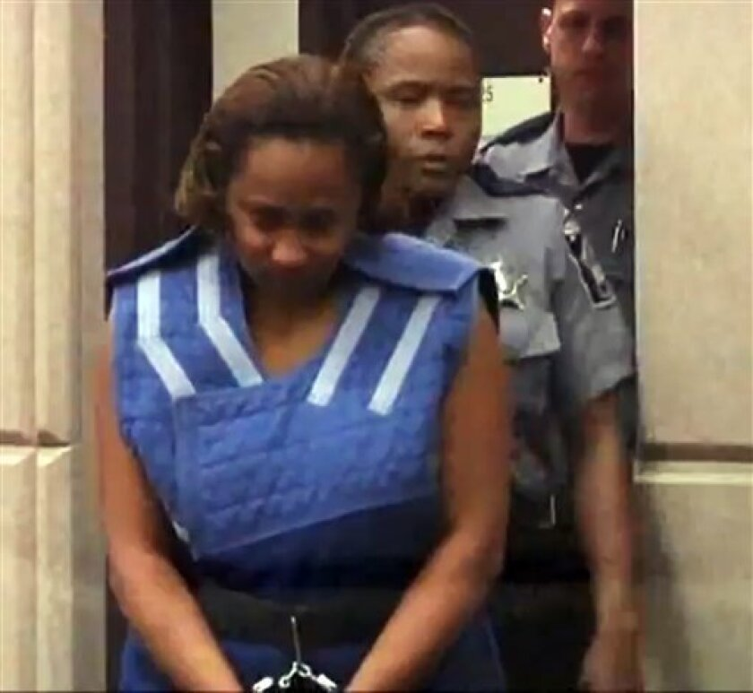In this Monday, Oct. 10, 2011 frame grab, Annette Morales-Rodriguez enters court in Milwaukee, Wis. Morales-Rodriguez, 33, faces one count each of first-degree intentional homicide while armed and first-degree intentional homicide of an unborn child while armed in the death of Maritza Ramirez-Cruz and the baby she was set to deliver next week. (AP Photo/Carrie Antlfinger)