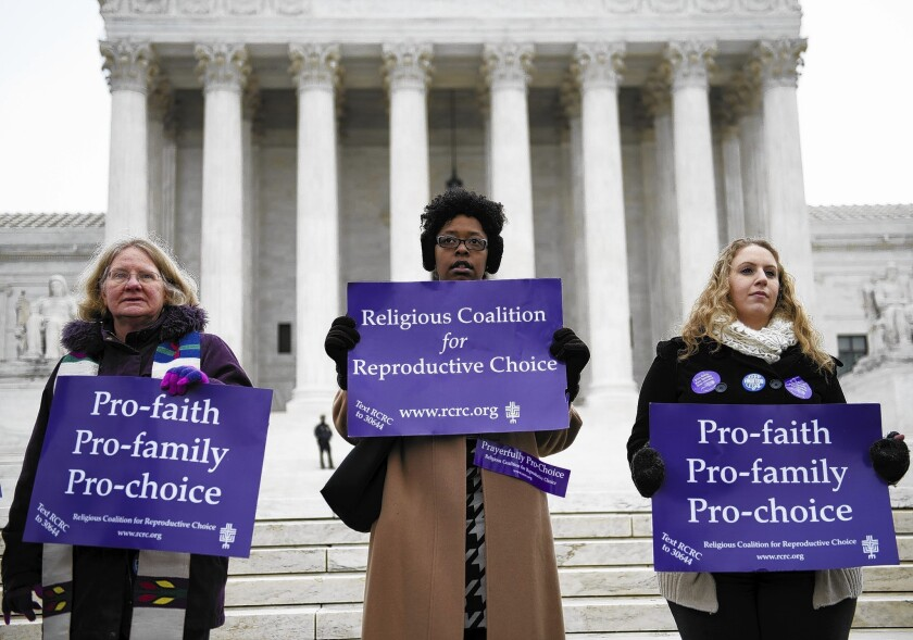 Supporters of the Massachusetts law establishing a 35-foot buffer zone at abortion clinics demonstrate outside the Supreme Court in Washington.