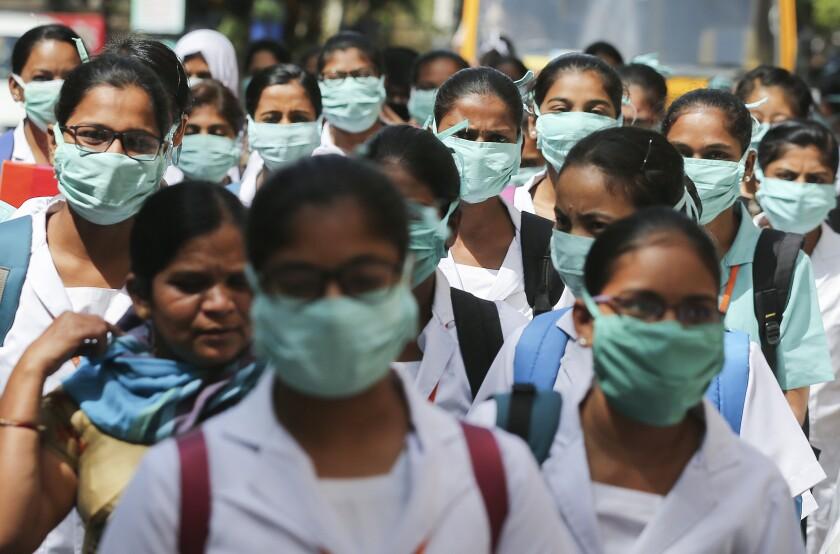 Indian nursing students wear masks at Gandhi Hospital in Hyderabad