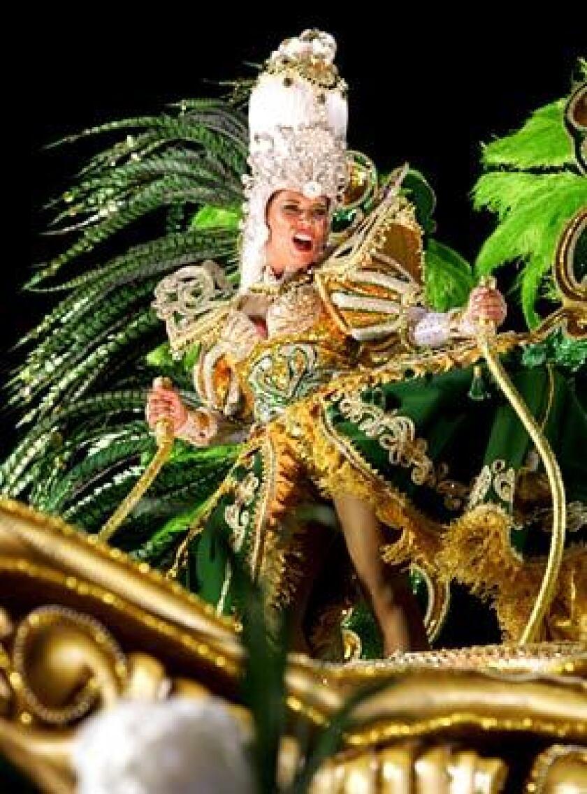 A dancer performs atop a float at the Sambodrome in Rio de Janeiro.