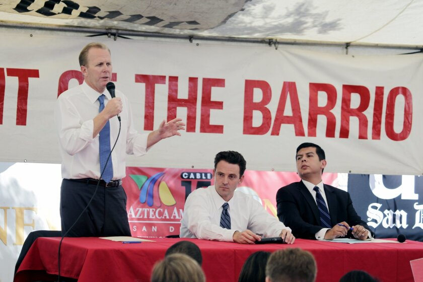 From left: mayoral candidates Kevin Faulconer, Nathan Fletcher and David Alvarez debated during the second debate held at the Logan Heights Family Health Center. Howard Lipin