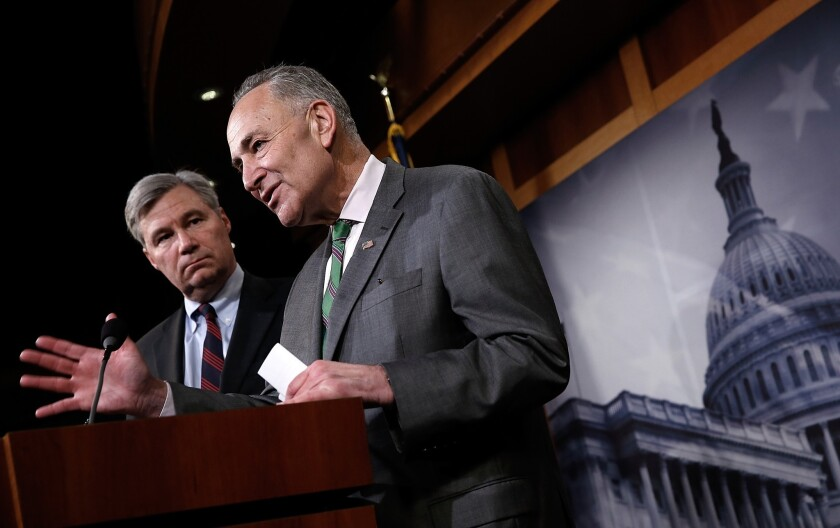 U.S. Sen. Charles Schumer (D-N.Y.), right, and Sen. Sheldon Whitehouse (D-R.I.) speak during a press conference at the Capitol on the Supreme Court's decision on campaign financing in McCutcheon vs. F.E.C.