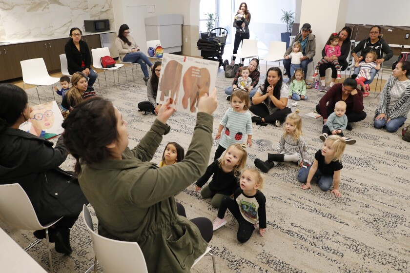 Staff members read stories in English and Spanish during Bilingual Storytime at the Donald Dungan Library in Costa Mesa in January. The Dungan Library and all other branches in the OC Public Libraries system are closing for the rest of March in response to the coronavirus.