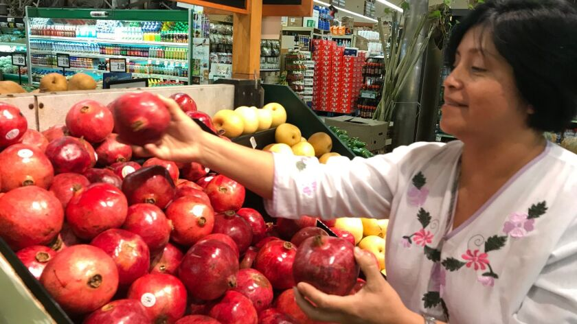Rebeca Gonzalez says she can now afford to buy pomegranates for her family because of the extra mone