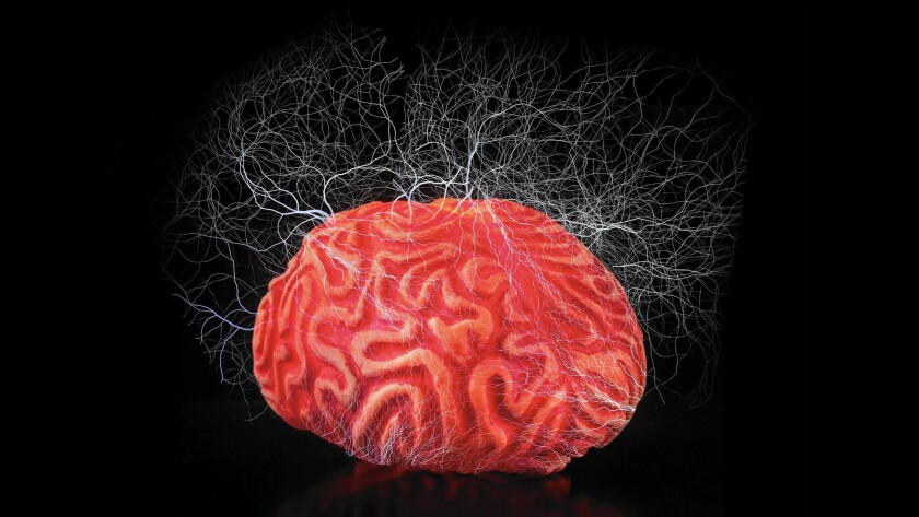 Photo illustration of a red rubber brain surrounded by electricity