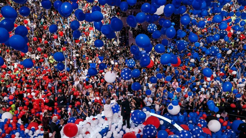 Balloons and confetti fall on Hillary Clinton and Tim Kaine at the end of the Democratic National Convention in Philadelphia, Pa., on July 28, 2016. Democrats aren't looking for a repeat performance, a new poll indicates.