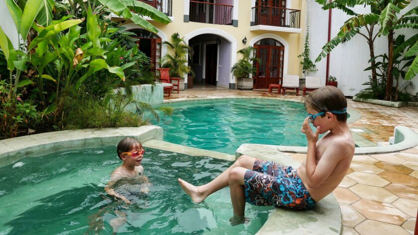 Liam and Reid cool off in the saltwater pool at Hotel La Polvora in Granada, Nicaragua.